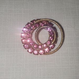 Pink and gold brooch